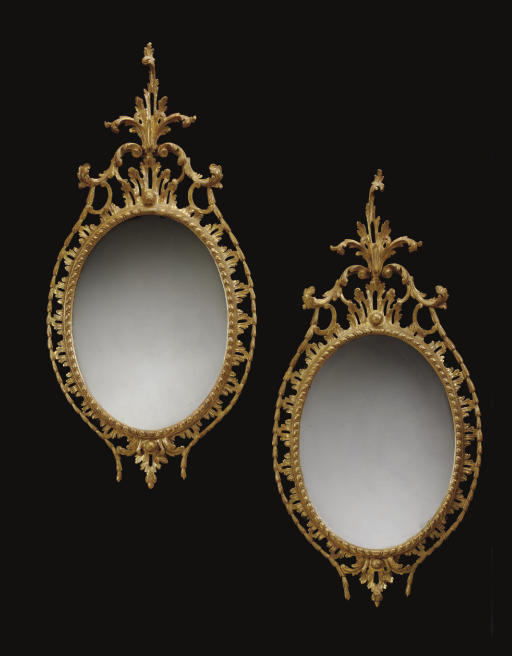A PAIR OF GILTWOOD OVAL PIER GLASSES
