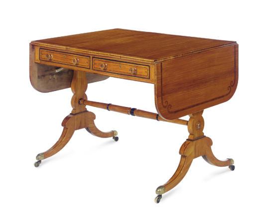 A REGENCY SATINWOOD AND EBONIZED SOFA TABLE