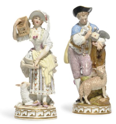 A MATCHED PAIR OF FIGURES OF A