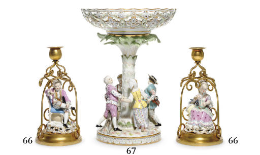 A PAIR OF MEISSEN FIGURES MOUNTED AS CANDLESTICKS