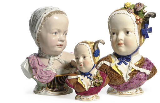 A PAIR OF MEISSEN KINDERBUSTS
