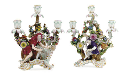 A MATCHED PAIR OF MEISSEN FLOWER-ENCRUSTED FIGURAL THREE-LIGHT CANDELABRA