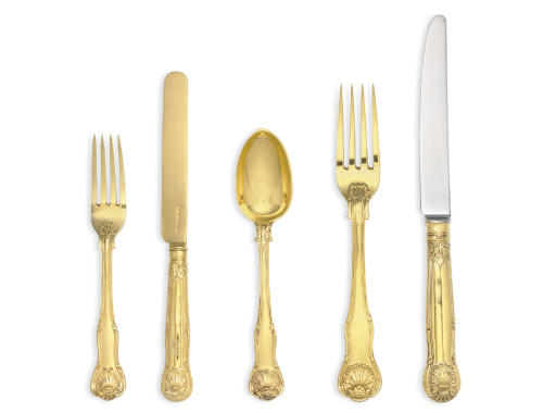 A VICTORIAN SILVER-GILT TABLE SERVICE
