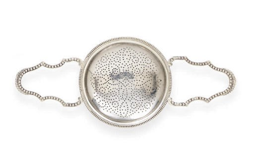 A GEORGE III SILVER PUNCH STRA
