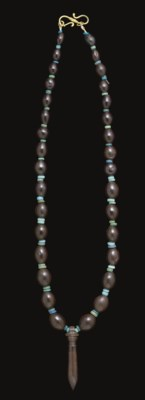 AN EGYPTIAN HAEMATITE AND FAIE
