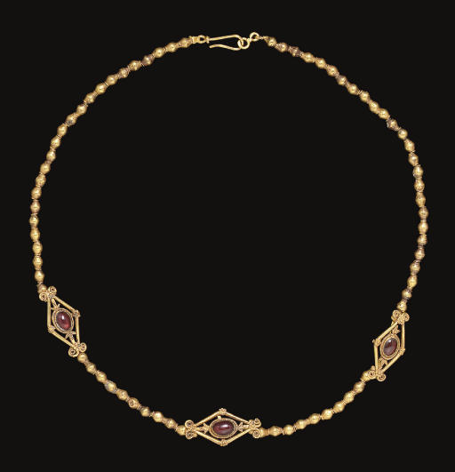 A GREEK GOLD AND GARNET NECKLA
