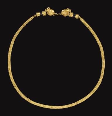 A GREEK GOLD AND BLACK STONE N