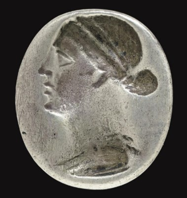 A GREEK SILVER FINGER RING WIT