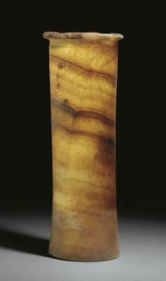 AN EGYPTIAN ALABASTER VESSEL