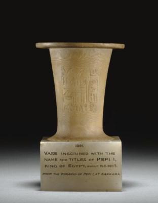 AN EGYPTIAN ALABASTER VASE INS