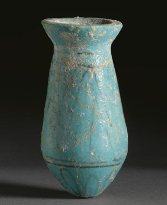 AN EGYPTIAN FAIENCE VASE