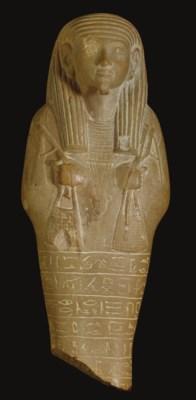 AN EGYPTIAN YELLOW LIMESTONE S