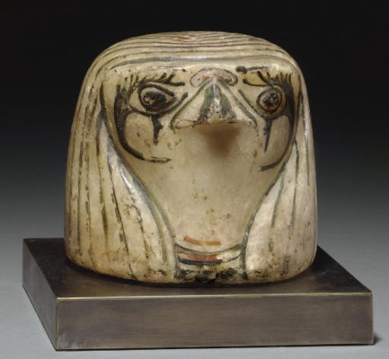 AN EGYPTIAN PAINTED ALABASTER