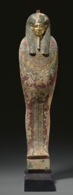 AN EGYPTIAN GILT AND PAINTED W