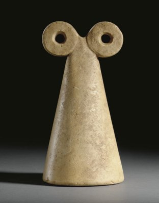 A SYRIAN STONE SPECTACLE IDOL