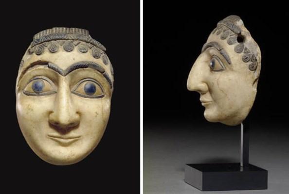 A MESOPOTAMIAN LIMESTONE HEAD