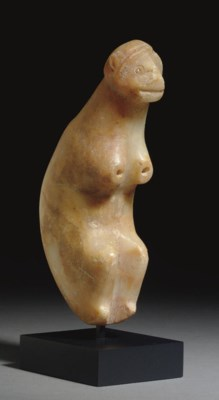 A BACTRIAN ALABASTER SEATED MO