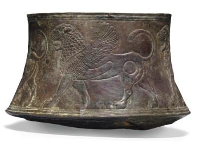 AN ASSYRIAN BRONZE BASIN