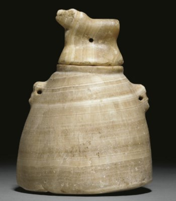 A SOUTH ARABIAN ALABASTER LIDD