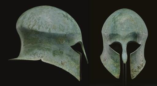 A GREEK BRONZE HELMET OF CORIN
