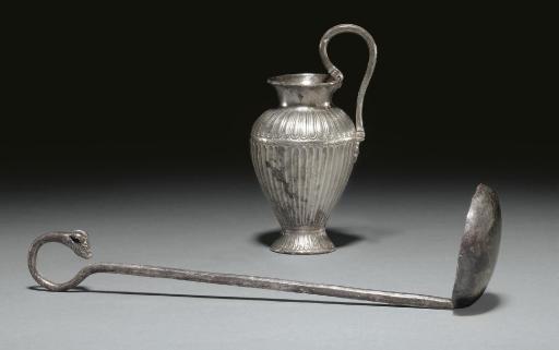 AN EAST GREEK OINOCHOE AND LAD