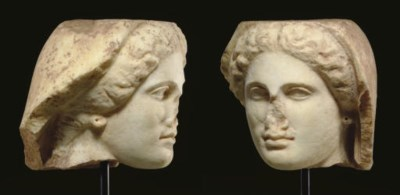 A GREEK MARBLE HEAD OF A WOMAN