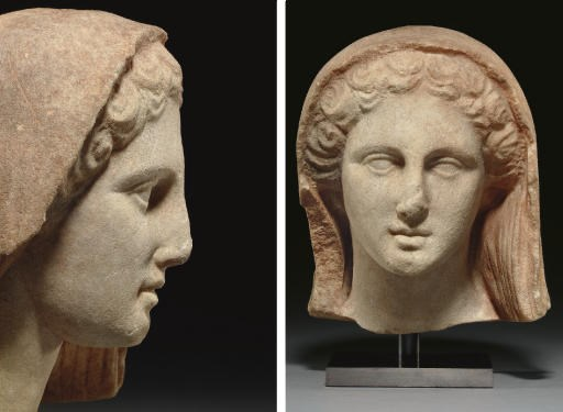 A GREEK MARBLE HEAD OF A WOMAN