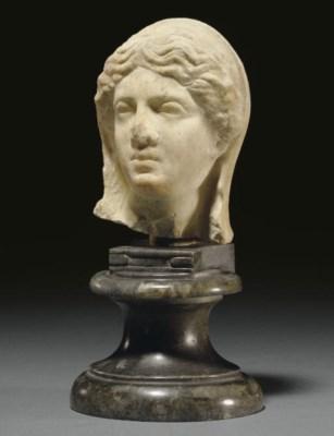 A ROMAN MARBLE FEMALE HEAD