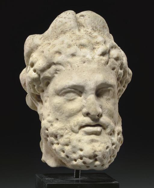 A ROMAN MARBLE HEAD OF HERCULE