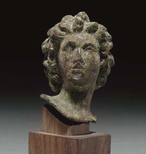 A ROMAN BRONZE HEAD OF A LAR