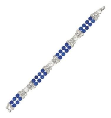 AN ART DECO DIAMOND AND BLUE-G