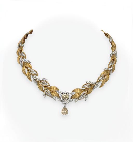 A COLORED DIAMOND AND GOLD NEC