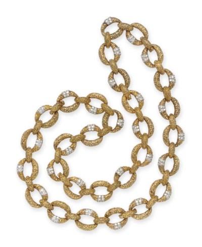 A GOLD AND DIAMOND LONGCHAIN N