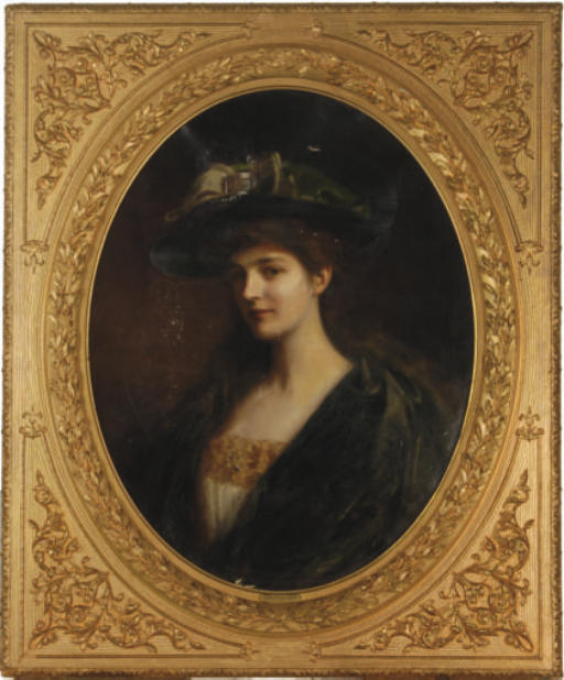 Portrait of a young beauty in a green hat and robe