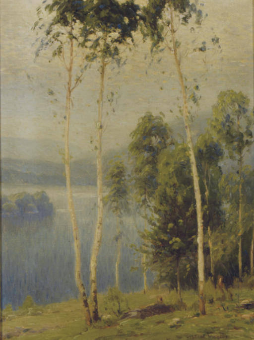 Lake with rolling hills in the background