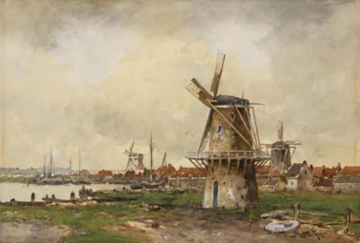 Windmills near the water's edge