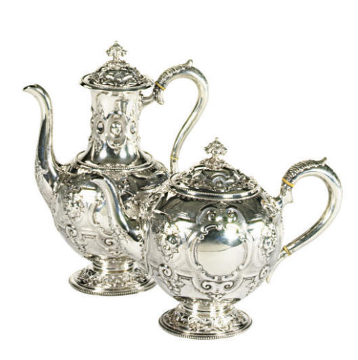A VICTORIAN SILVER FOUR-PIECE TEA AND COFFEE SERVICE**,