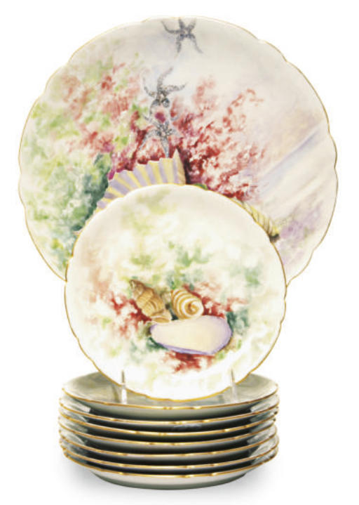A LIMOGES PORCELAIN SET OF EIG