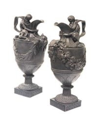 A PAIR OF WEDGWOOD BLACK BASALTES EWERS FOR WATER AND WINE, 'SCARED TO NEPTUNE AND BACCHUS'