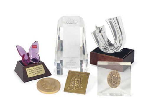 A GROUP OF AWARDS PRESENTED TO