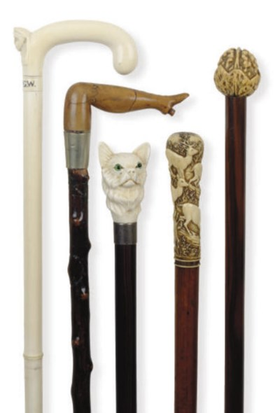 A GROUP OF EIGHT WALKING CANES