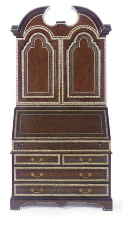A LEATHER BOUND BUREAU BOOKCAS