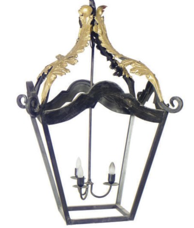 A WROUGHT IRON AND PARCEL-GILT