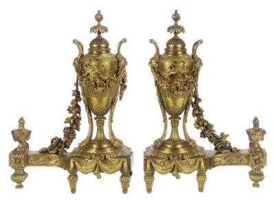 A PAIR OF GILT-BRONZE CHENETS,