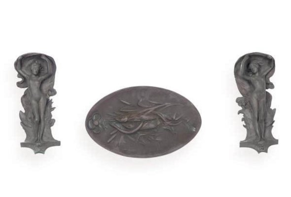 A PAIR OF PATINATED BRONZE REL