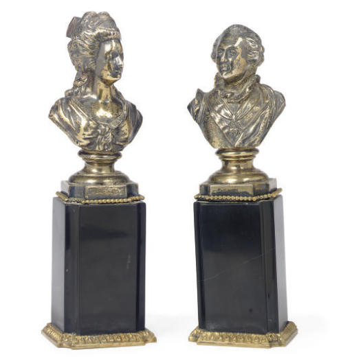 A PAIR OF SILVER-PLATED BUSTS