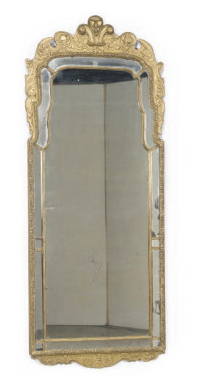 A GILTWOOD WALL MIRROR,