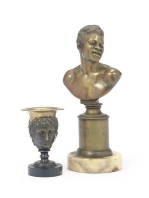 A PATINATED BRONZE BUST OF A M