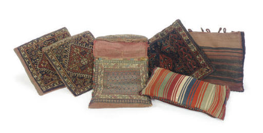 A GROUP OF WOVEN BAGS CONVERTE
