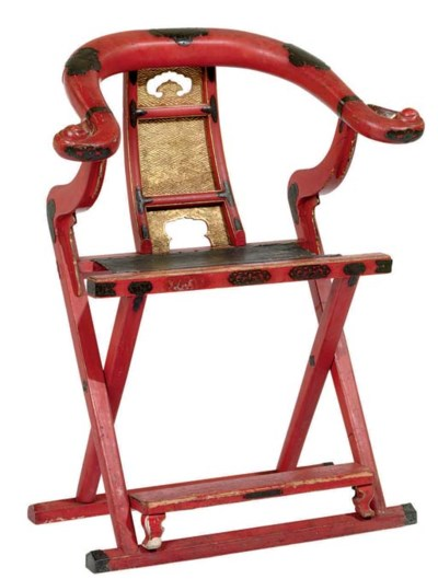 A JAPANESE GILT-DECORATED RED-